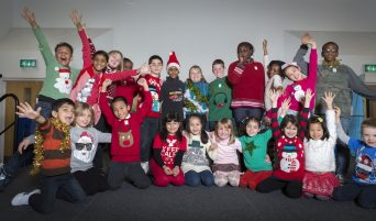 "Children show off their knitwear for Xmas Jumper Day 2013, at their Primary School in Barnet, North London.   Save the Children fundraiser invites everyone one in the UK to ""make the world better with a sweater"" on Friday 13 December by wearing a Christmas jumper for the day and giving £1 or more to Save the Children."